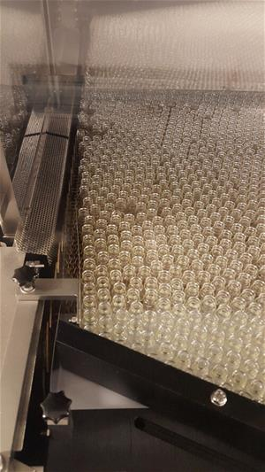 A manufacturing line full of glass vials